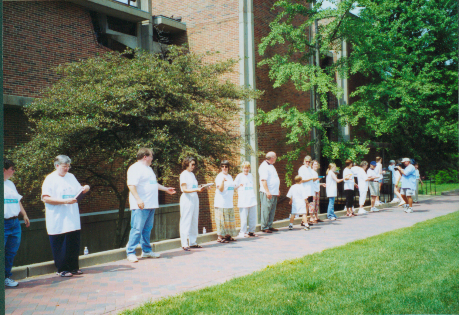 [Color photograph of people book chain outside of Luhr Library]